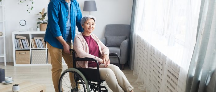 disabled-woman-with-caregiver-MJN8FZ7